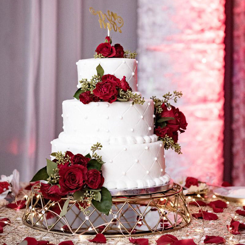This real wedding montage includes wedding cake with white frosting and red roses